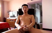 Skinny Asian stroking cock