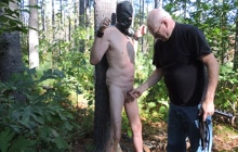 Mature master whipping his slave
