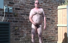 Horny bear playing with his dick outdoors
