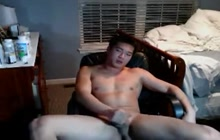 Hot Asian dude playing with himself on webcam