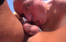 Bald dude gives blowjob outdoor
