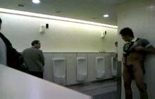 Kinky dude jerking off in public restroom