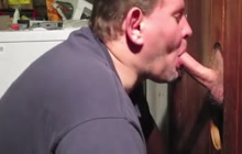 Cock sucking trough a gloryhole